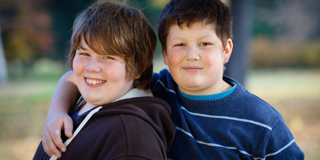 Friendship: portrait of two cute overweight boys