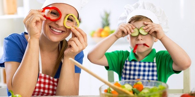 Family have fun in the kitchen with vegetables