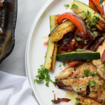 Fish fillets with sautéed peppers and balsamic reduction